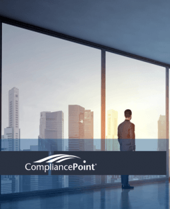 man looking out office window